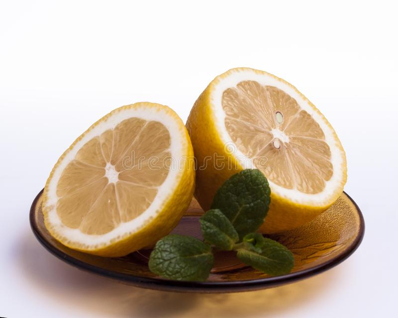 Sliced lemon with mint royalty free stock photography