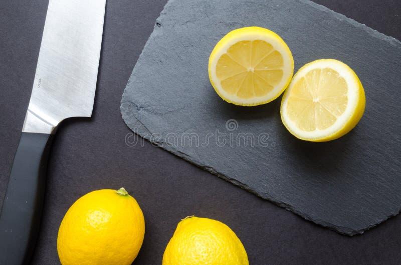 Sliced Lemons on Black Surface royalty free stock photos