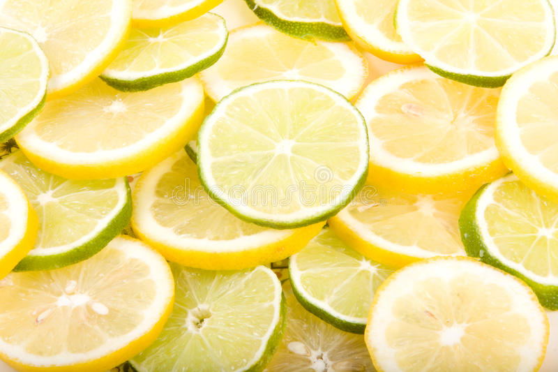 Sliced lemons and limes Close-Up stock photos