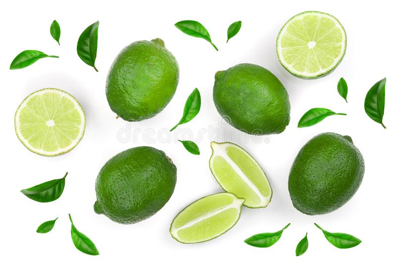 Sliced lime with leaves isolated on white background. Top view. Flat lay pattern stock photos