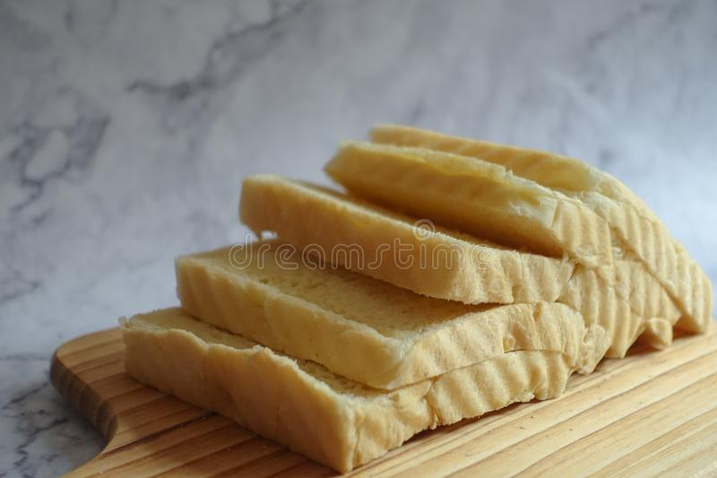 Sliced Loaf Bread on Chopping Boar stock photography