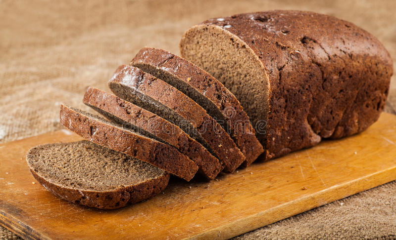 Sliced loaf brown bread royalty free stock photos