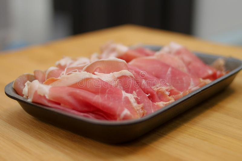 Sliced meat on the market stock images