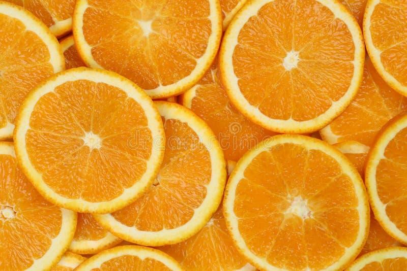 Sliced orange background royalty free stock photography