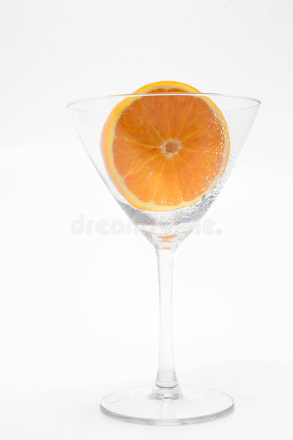Sliced Orange Martini Glass. A freshly sliced orange in a martini glass royalty free stock images
