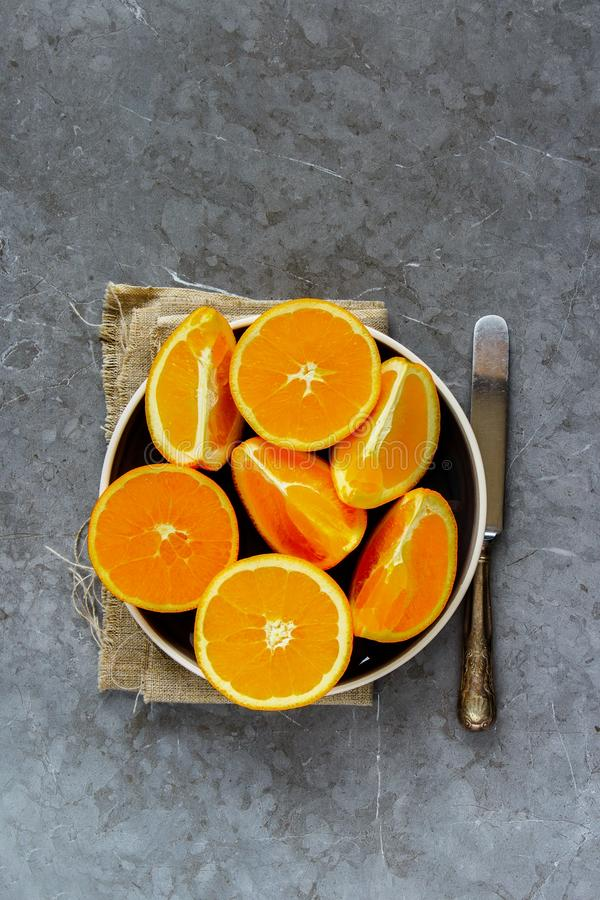 Sliced orange on plate royalty free stock photography