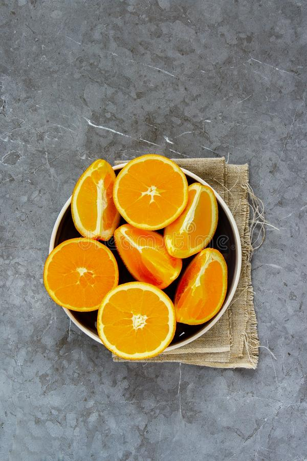 Sliced orange on plate royalty free stock images