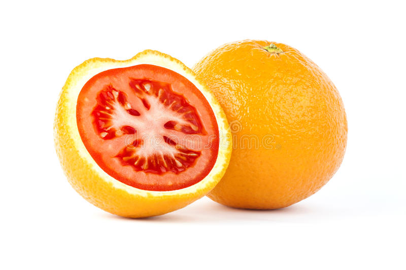 Sliced orange with red tomato inside royalty free stock image
