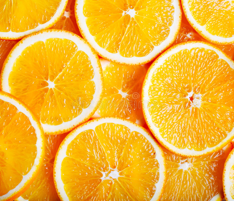 Sliced oranges. In a pattern as a background