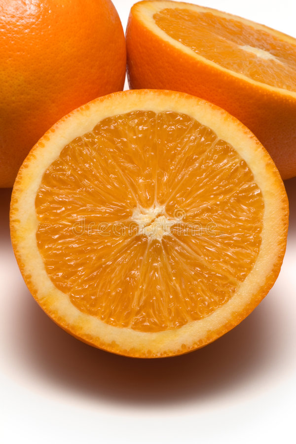 Sliced Oranges. Close-up of sliced oranges on white surface stock photography