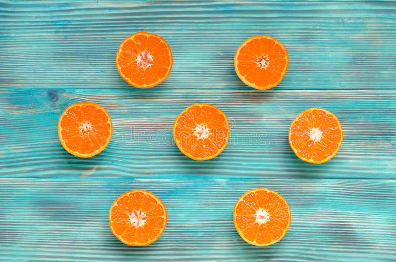 Sliced oranges on wooden background royalty free stock photography
