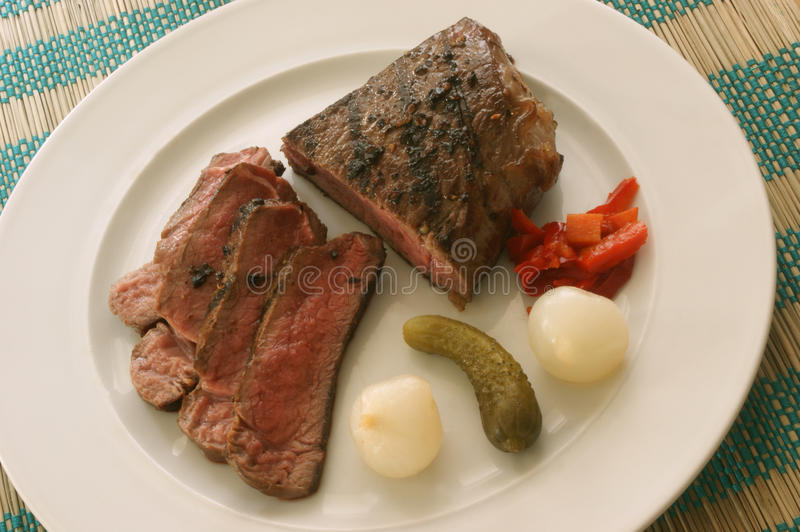 Sliced pepper steak with sour vegetables royalty free stock photo