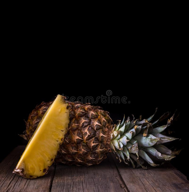 Sliced pineapple on old rustic desk Black background stock photos