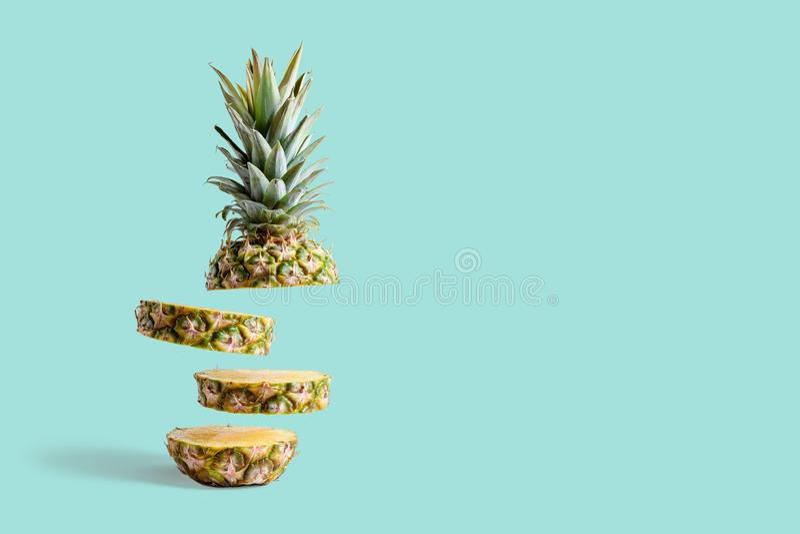 Sliced pineapple on pastel blue background. stock photo