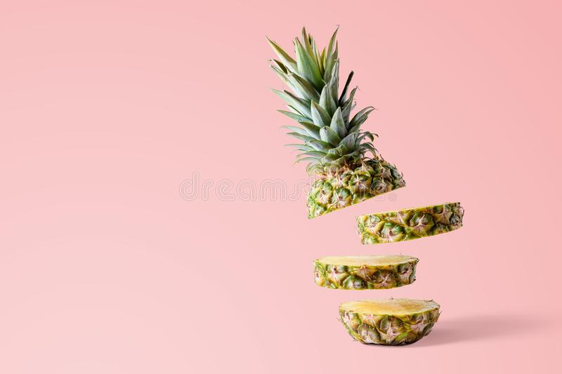 Sliced pineapple on pink bright background. Minimal fruit concept stock photos