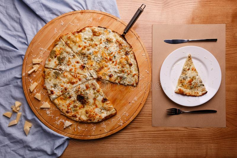 A sliced pizza on the table royalty free stock image