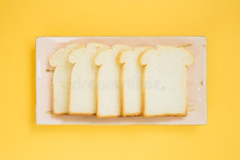 Sliced plain bread on dish stock photo