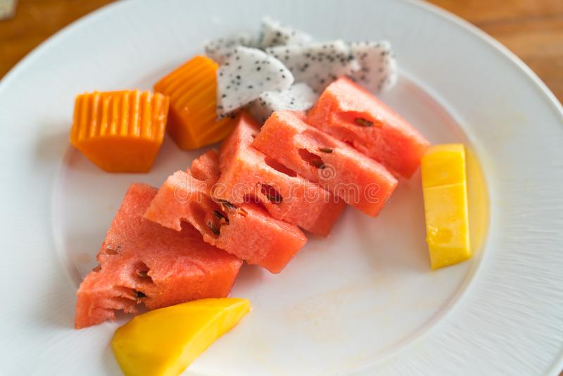 Sliced plated fruits ready to eat. Sliced plated fruit selection real food in selective focus ready to eat royalty free stock photography