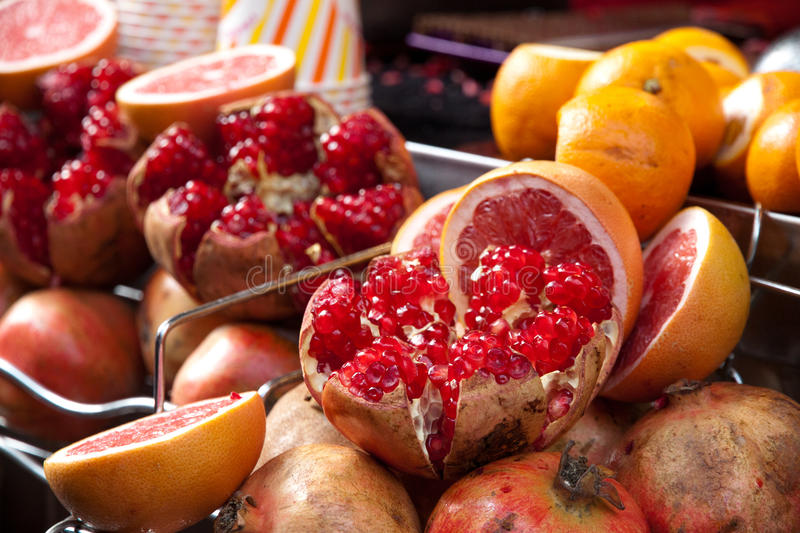 Sliced pomegranate fruits lie on market in Istanbul royalty free stock photography