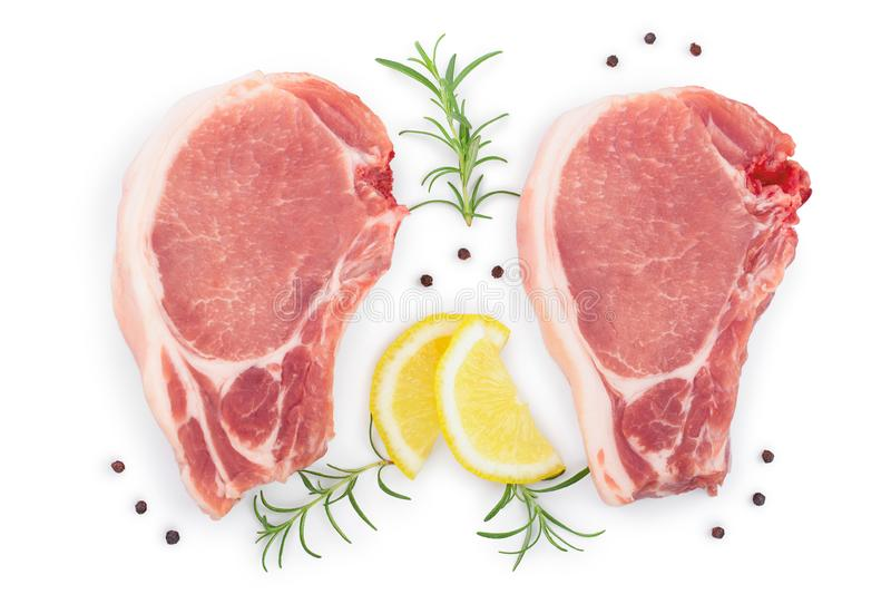 Sliced raw pork meat with rosemary and lemon isolated on white background. Top view. Flat lay royalty free stock images