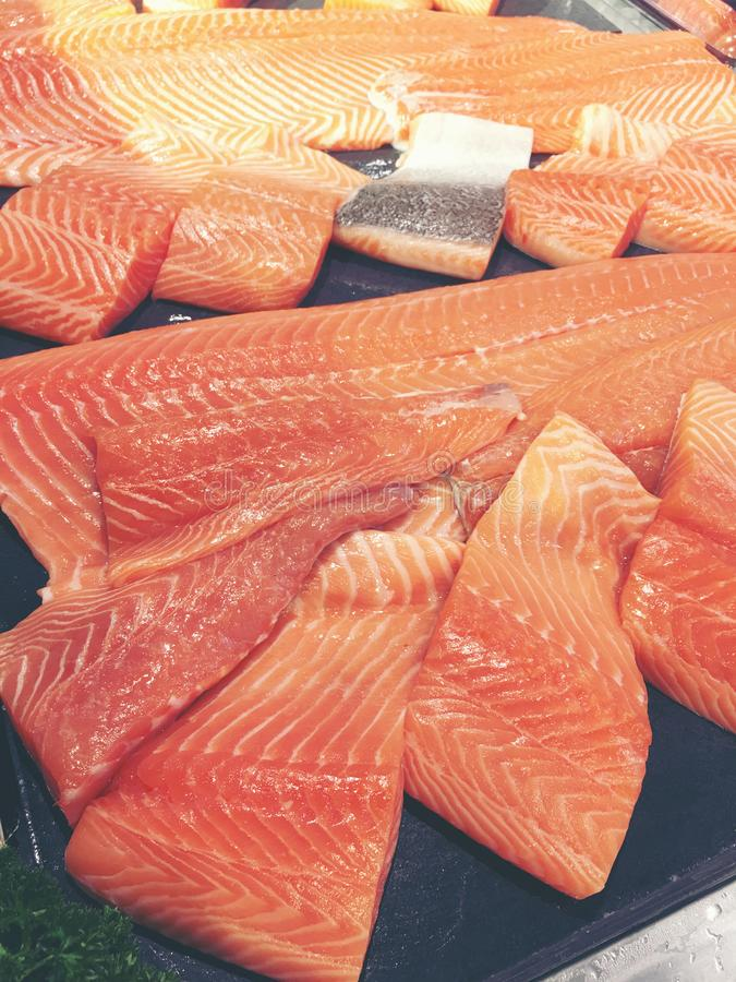 Sliced raw salmon or fresh salmon. Salmon fillets for sale at market displayed with a patchwork effect. Many fresh salmon fish stock images