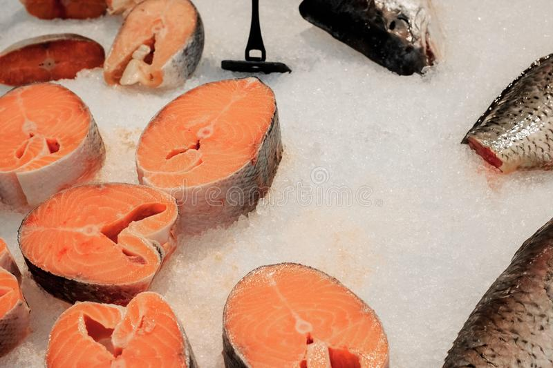 Sliced red fish on ice close up royalty free stock photography