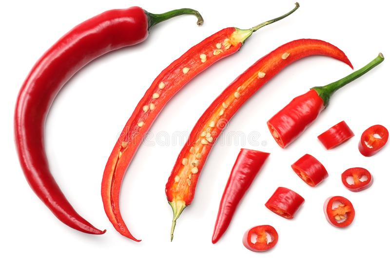 Sliced red hot chili peppers isolated on white background top view royalty free stock images