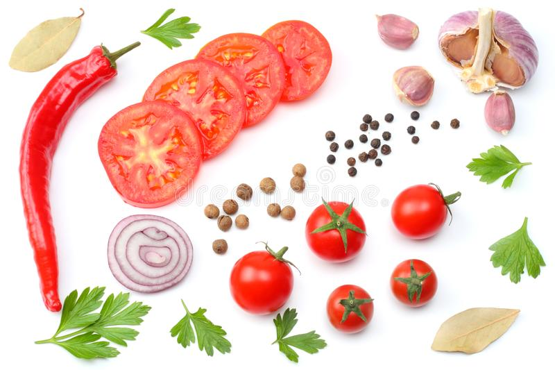 sliced red onion, red hot chili pepper, tomato, garlic and spices isolated on white background. top view royalty free stock image