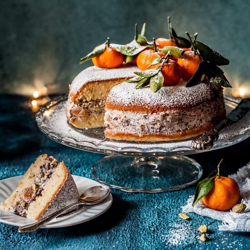 Sliced Ricotta Tangerine Cake. Sliced Ricotta, Pistachio, Chocolate and Tangerine Cake, square royalty free stock photo