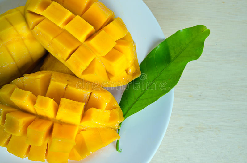 Download Sliced Ripe Yellow Mango With Leaf Stock Photo - Image: 70161712