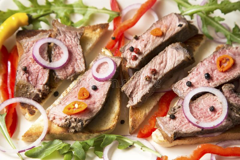 Sliced roast beef with vegetables royalty free stock images