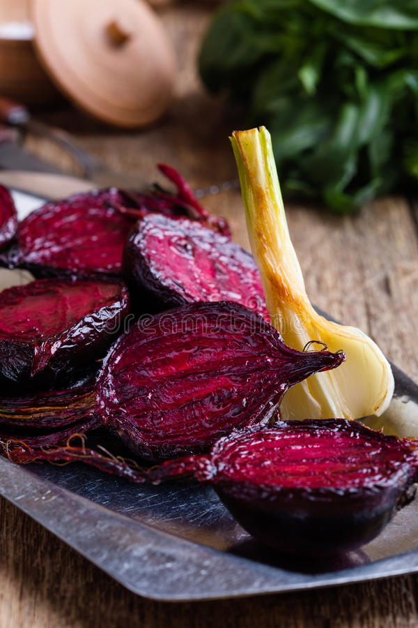 Sliced roasted beetroot on rustic outdoor party table. Sliced baked beetroot on rustic outdoor party table, diet and healthy eating food concept stock image