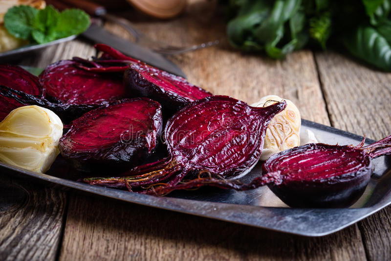 Sliced roasted beetroot on rustic outdoor party table. Sliced baked beetroot on rustic outdoor party table, diet and healthy eating food concept royalty free stock photo