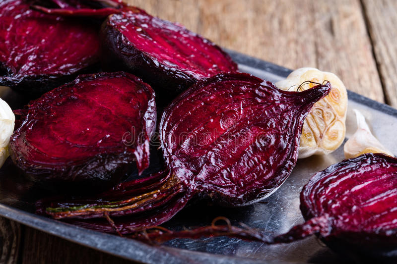 Sliced roasted beetroot on rustic outdoor party table. Sliced baked beetroot on rustic outdoor party table, diet and healthy eating food concept stock photography
