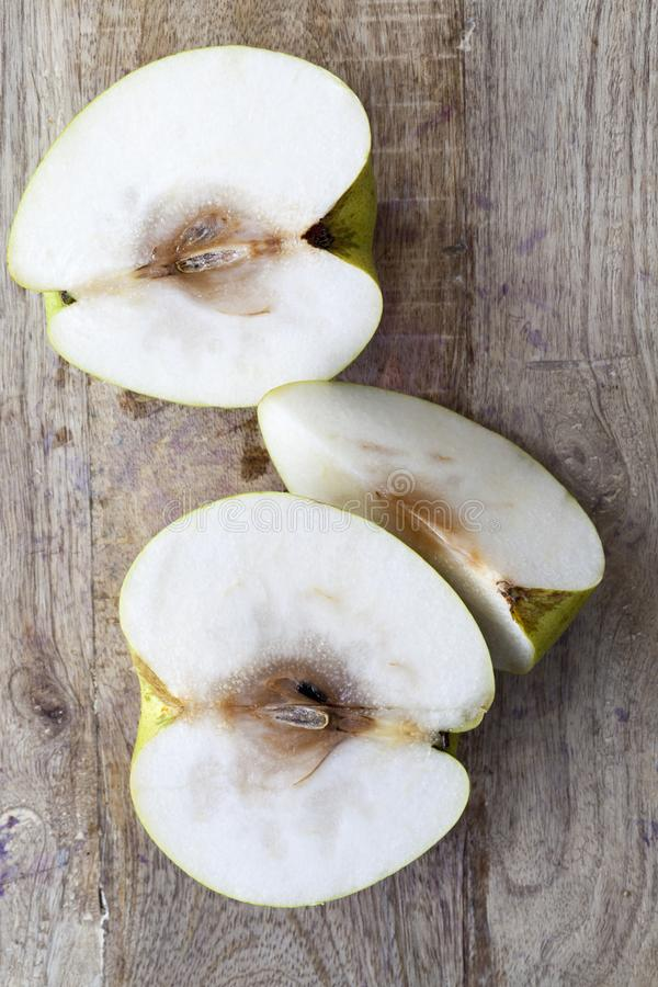 sliced rotten pear stock images