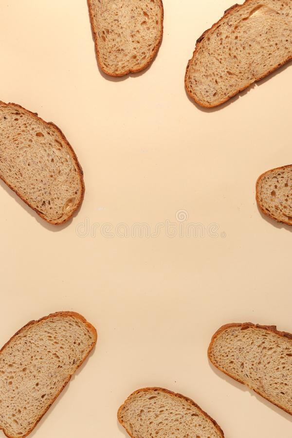 Sliced of rye bread, isolated on a brown background. Breakfast wheat closeup nutrition meal food loaf fresh white healthy whole texture tasty grain cereal stock photo