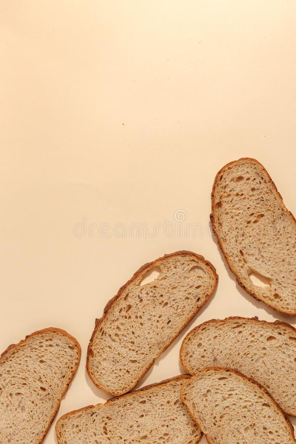 Sliced of rye bread, isolated on a brown background. Breakfast wheat closeup nutrition meal food loaf fresh white healthy whole texture tasty grain cereal royalty free stock images