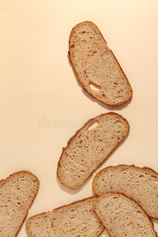 Sliced of rye bread, isolated on a brown background. Breakfast wheat closeup nutrition meal food loaf fresh white healthy whole texture tasty grain cereal stock images