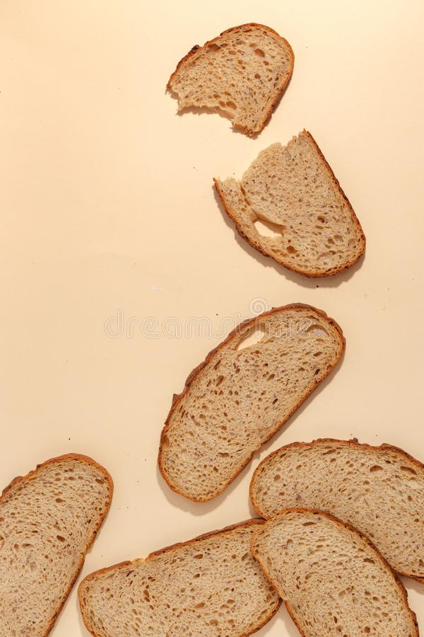 Sliced of rye bread, isolated on a brown background. Breakfast wheat closeup nutrition meal food loaf fresh white healthy whole texture tasty grain cereal stock photography