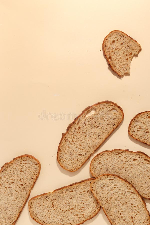 Sliced of rye bread, isolated on a brown background. Breakfast wheat closeup nutrition meal food loaf fresh white healthy whole texture tasty grain cereal royalty free stock photos