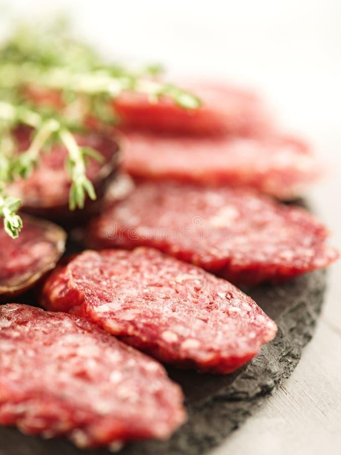 Sliced salami on cutting board royalty free stock photo