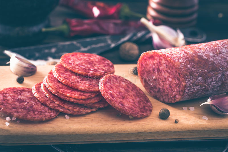 Sliced salami on cutting board royalty free stock photography
