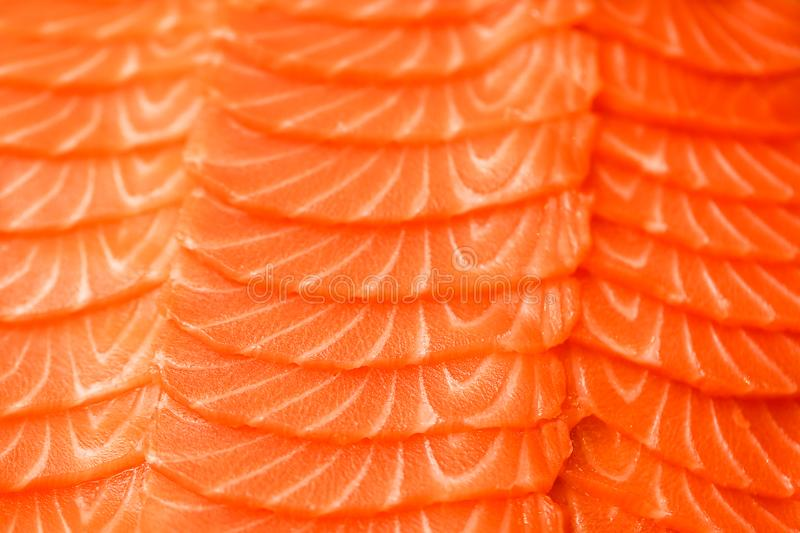 Sliced salmon fillet. Close-up texture photo. Macro photography. Food concept background royalty free stock photography
