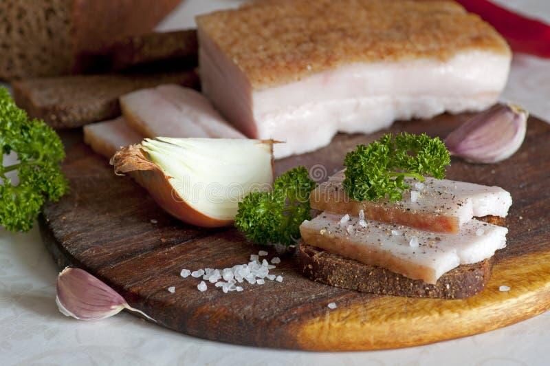 Sliced salted pork lard (salo) stock images