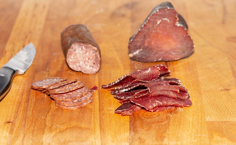 Ham. Sausage. Wooden. Meat. Smoked. Knife stock images