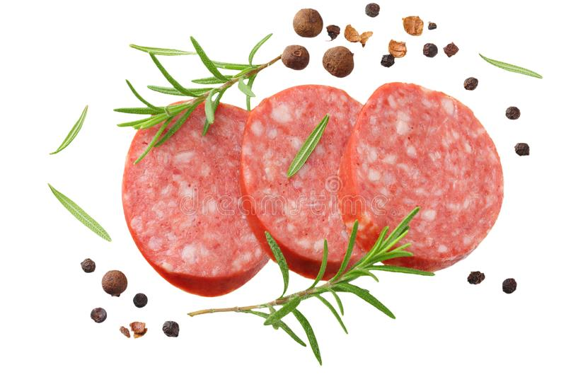 sliced sausage salami with rosemary and peppercorns isolated on white background. top view stock images