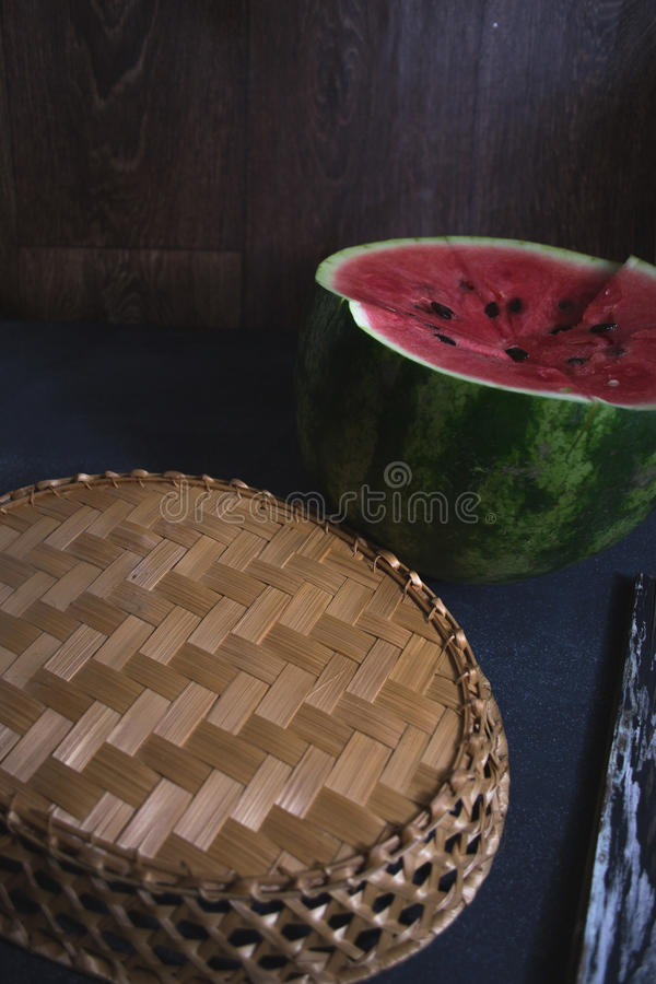 Sliced slices of watermelon on a dark background. stock photos