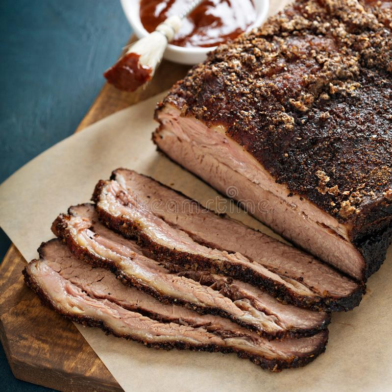 Sliced slowly cooked brisket. With bbq sauce royalty free stock photos