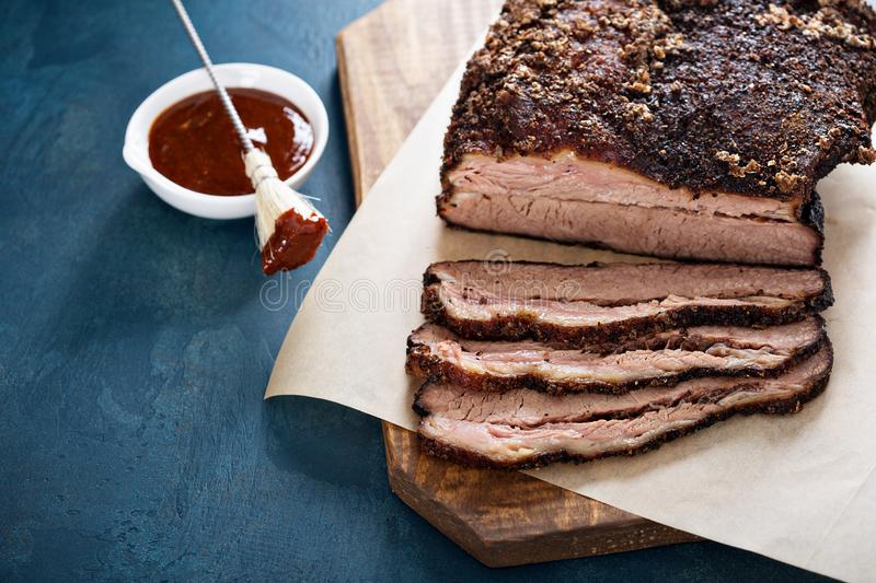Sliced slowly cooked brisket. With bbq sauce stock photography