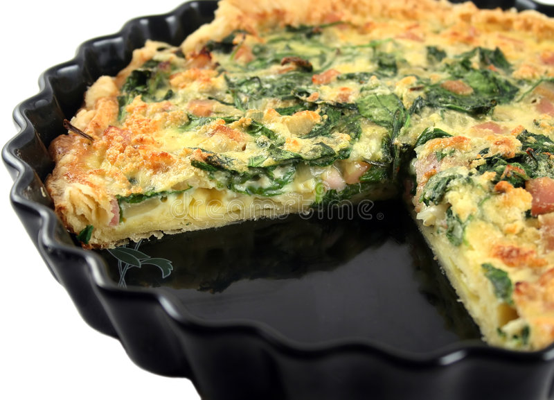 Sliced Spinach And Bacon Quiche royalty free stock images